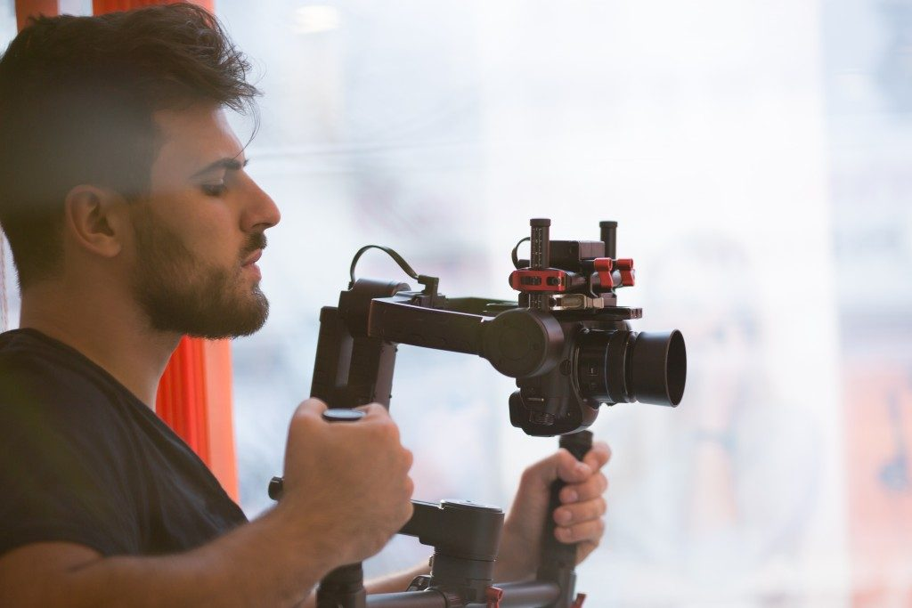 videographer with gimball video slr