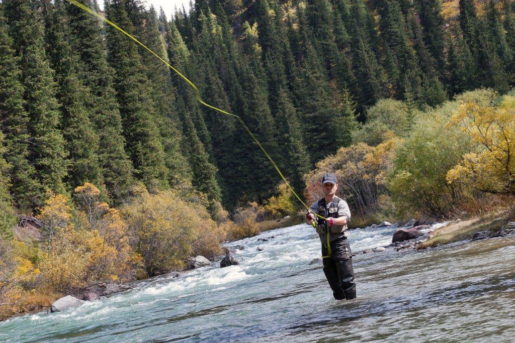 Man fishing on water