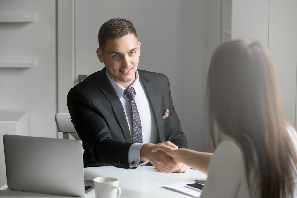 man shaking hands with a client