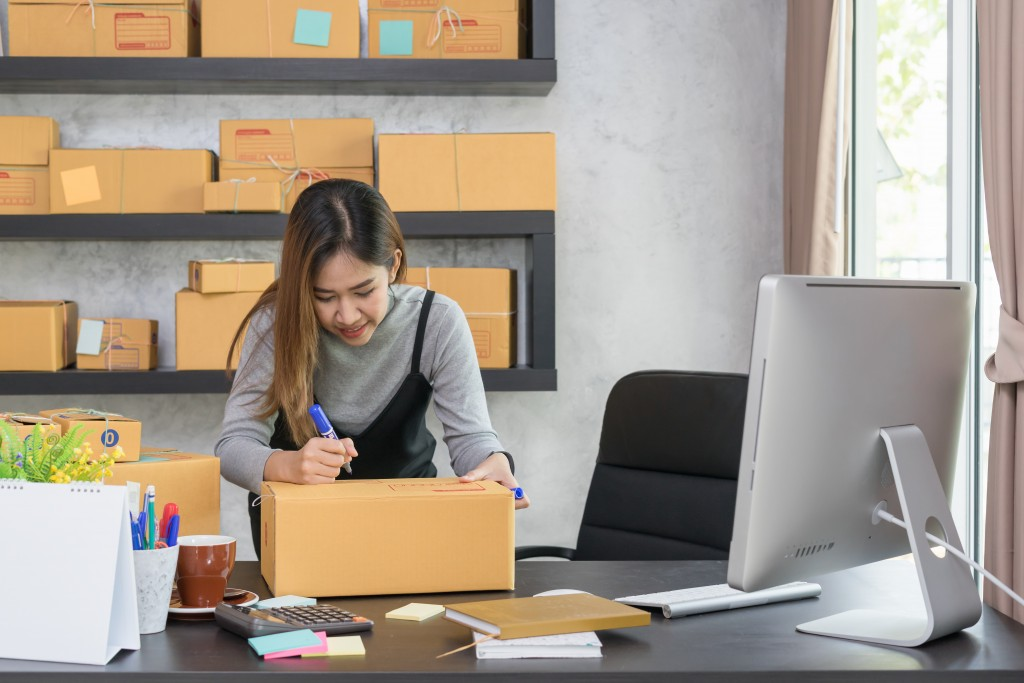 woman managing her ecommerce business