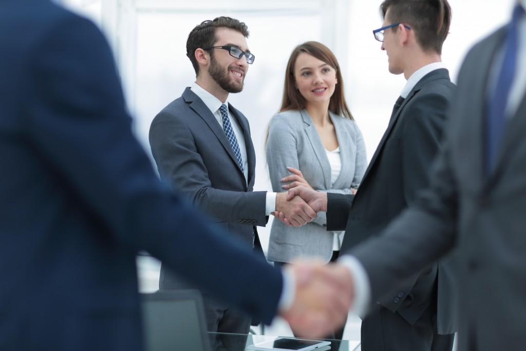 Businessman handshake with franchisee