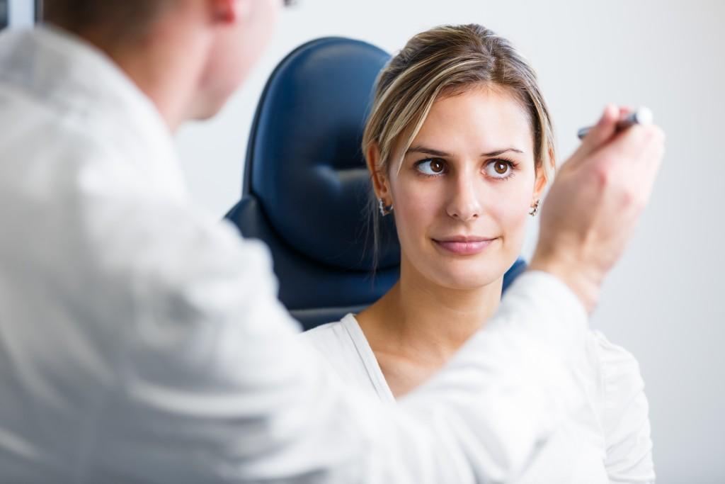 eye doctor examining his patient