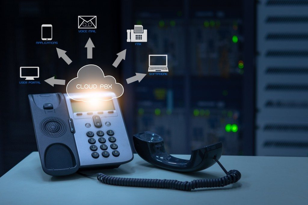 telephone device with illustration icon of voip services and networking data center on background