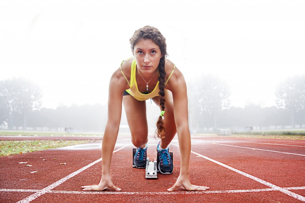Female runner in ready stance