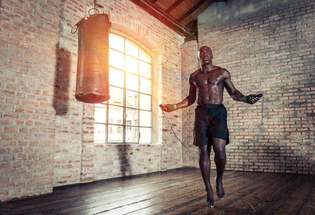 man skipping rope at the gym