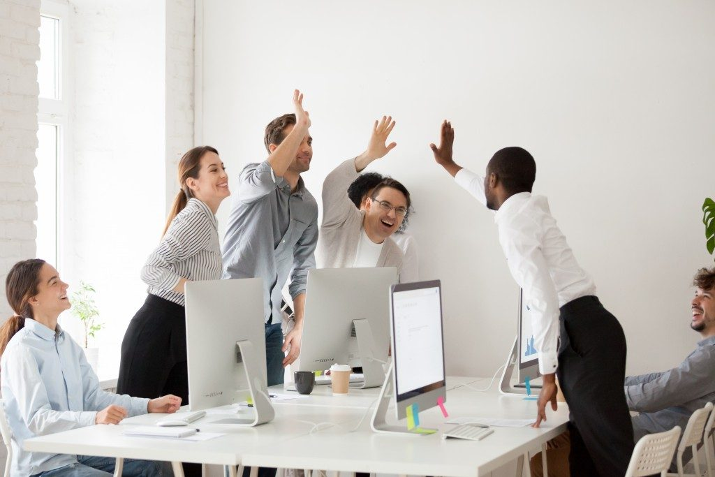 employees happy and giving high-fives