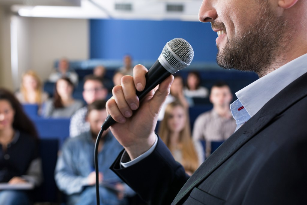Man presenting in front of an audience