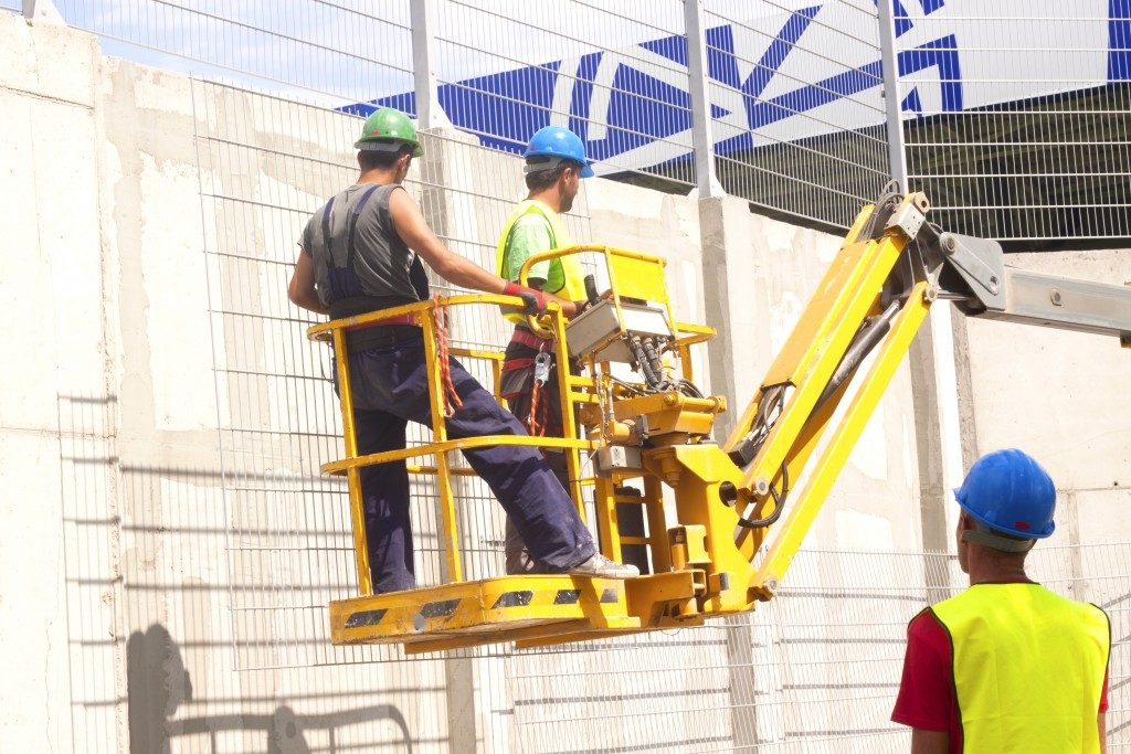 Workers on a lift