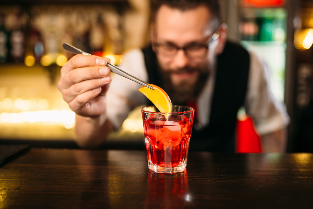 Bartender making alcohol coctail