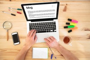 person writing a blog