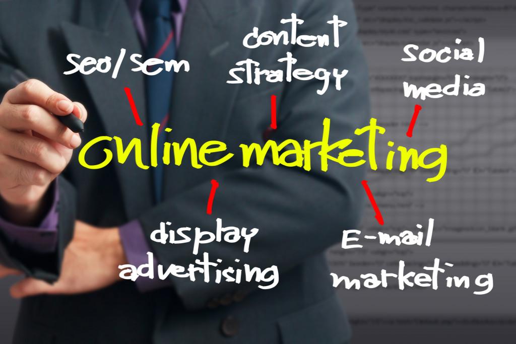 man drawing online marketing graphics